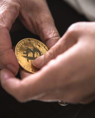 Bitcoin in Hands